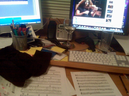 I usually worked by having the reference mp3 up on one machine and a video of a live performance of the piece on the other.  And yes, I could certainly use a bigger, better-designed workstation!  That's my shirt on the desk since it was so bloody hot and the A/C made too much noise so I had to turn it off
