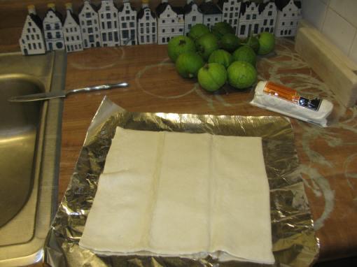 Unfolding the still semi-frozen prepared puff pastry