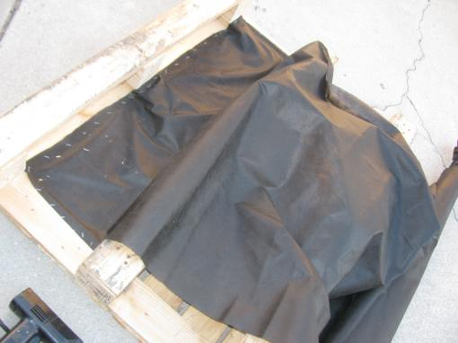 Attaching weed cloth to the pallets